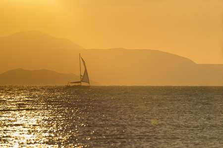aegean: backlit sunset sail Sailing in the Aegean Sea Stock Photo