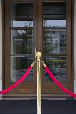 stanchion: Stanchion in front of a door entrance