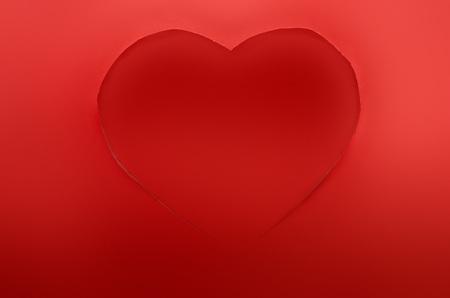 cut paper: Closeup of a red paper heart cut Stock Photo