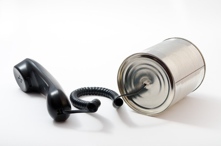 tin can telephone: telephone and tin can on a white background. technological leap.