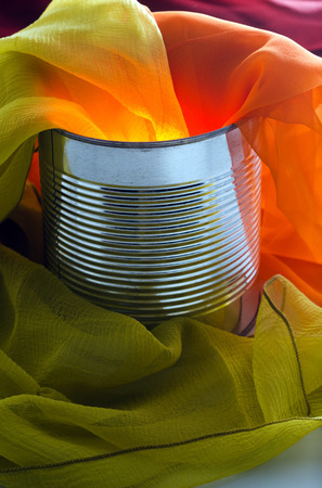 hanky: Scarves of many colors in a tin can Stock Photo