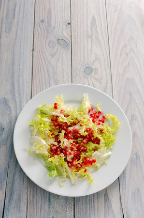 escarole: salad plate on a wooden table Stock Photo