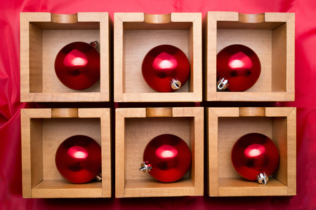saturated color: six red balls on wooden boxes
