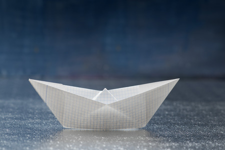 freedom leisure activity: Closeup of a paper boat on foil