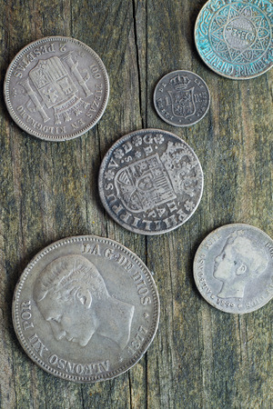 silver coins: Old silver coins on a wooden background