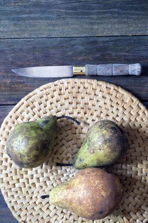 rattan mat: pears on a wicker mat