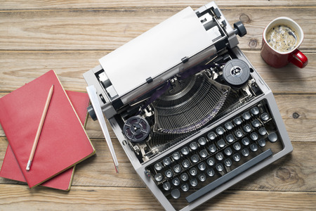 write letter: Vintage typewriter and a blank sheet of paper