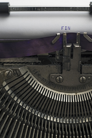 clearly: A closeup of an old fashioned typewriter with the words FIN clearly visible. Stock Photo