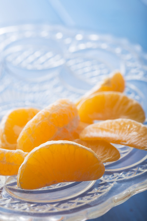 yello: mandarin orange sections in a glass tray Stock Photo