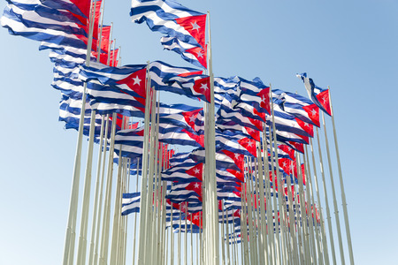 cuban culture: Group of cuban flags in the wind Stock Photo