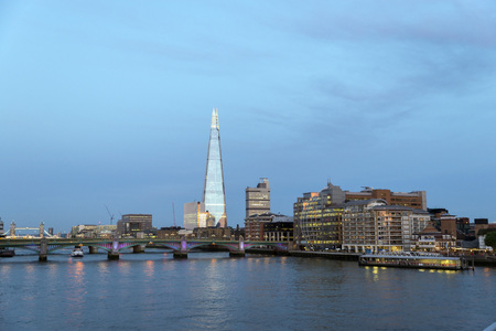 shard: Late afternoon sun lights up the London skyline. The Shard is the tallest skyscraper in Western Europe.