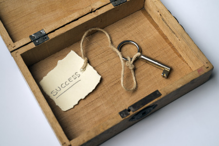 secret society: Wooden box containing the key to success