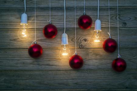 christmas decoration: lit light bulbs and Christmas baubles