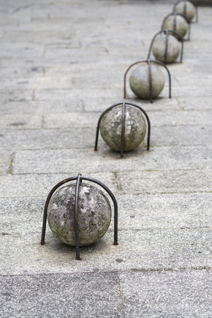 fastened: stone ball fastened with iron bars