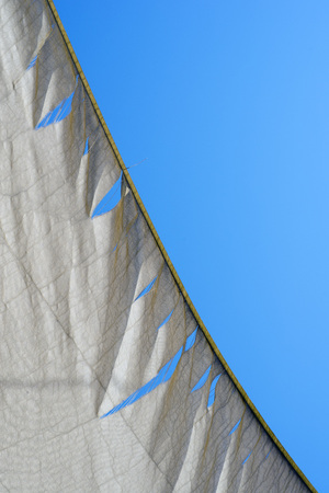 gash: torn and weathered white  awning. Stock Photo