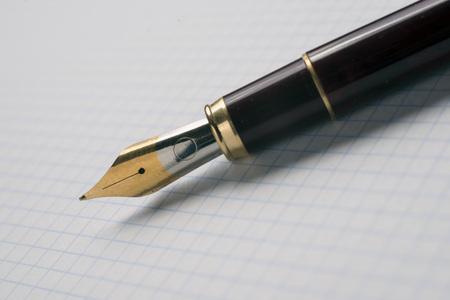 graph paper: Closeup of fountain pen on graph paper
