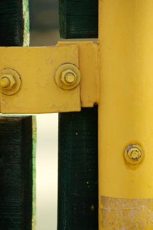 platen: Closeup of nuts and yellow metal bar