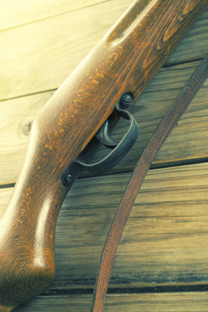 musket: rifle on a wooden background. Vintage Stock Photo