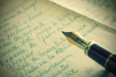 vintage look: fountain pen over old letters. Vintage look