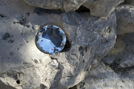 diamond shaped: diamond shaped glass on a rock Stock Photo