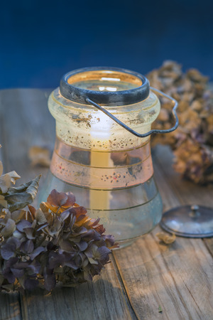 dried flower arrangement: dried hydrangea and glass jar with candle