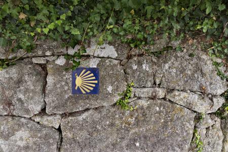 granite wall: Signpost Road Santiago on a granite wall. Spain