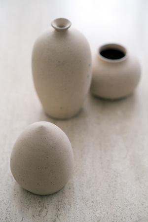 craft on marble: Still life with three  small jugs on a marble table, selective focus