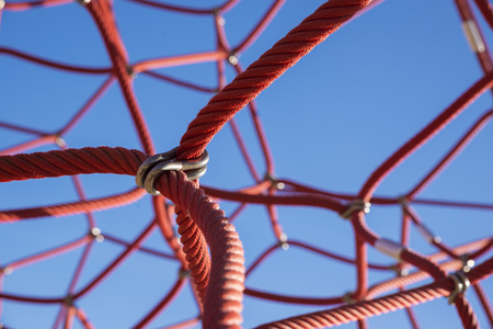 entanglement: Kids climbing frame in a public park on a sunny day