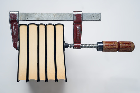archival: Concept that illustrate the traditional books printing, using the action of Presss with the screw clamp. White background Stock Photo