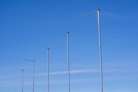 flagpoles: five flagpoles without flags
