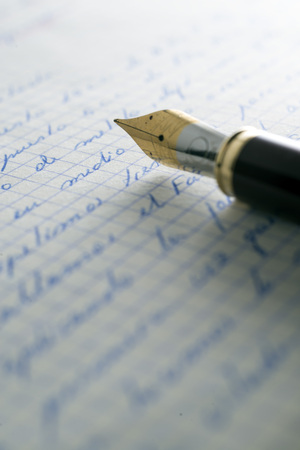 old letters: fountain pen over old letters.
