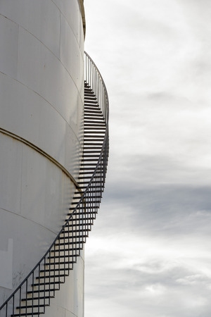 spiral staircase: Storage Tank with Spiral Staircase Stock Photo