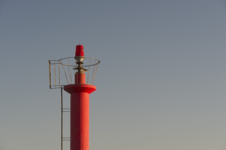 illuminative: Red lighthouse on clear sky at sunset