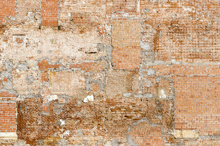 botched: heterogeneous brick wall in an old building Stock Photo