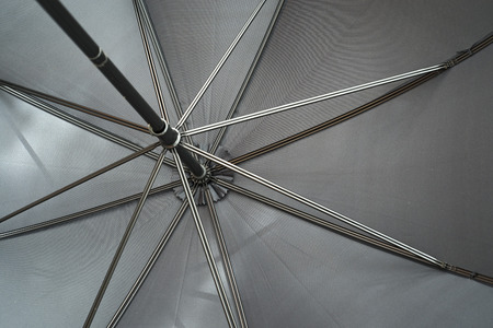 inclement weather: black umbrella with spokes from below