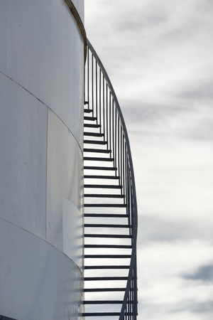 steps and staircases: Storage Tank with Spiral Staircase Stock Photo