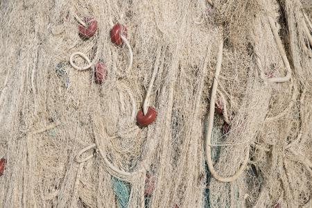 restraining device: old fisherman nets background