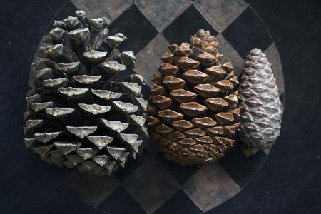 pinecones: three pinecones on a checkered tray