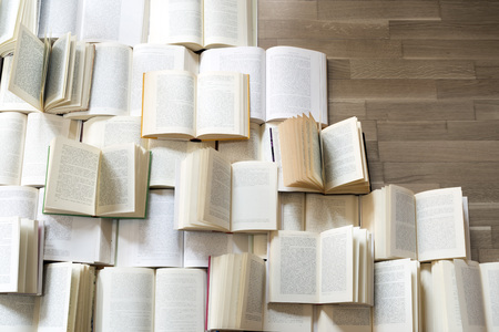reading book: Many open books piled up. unreadable text. Copy space