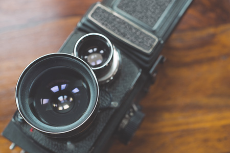 format: Closeup of old style photographic camera; medium format 6x6 cm.