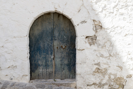 old doors: old door on a whitewashed wall. Ibiza Stock Photo