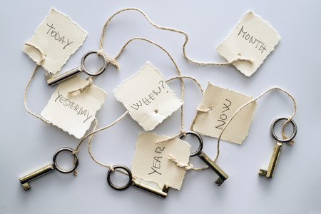 reminding: Five keys tied to six tags. allegory of memory and oblivion Stock Photo