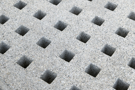 perforated: granite surface perforated with square holes