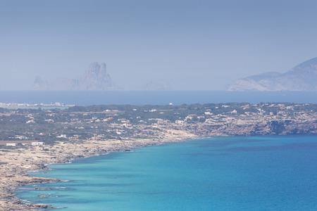 vedra: Formentera island, Spain. View on northern rocky coastline. On the horizon is Es Vedra