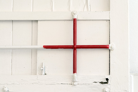 cross bar: painted red bars on a white painted door Stock Photo
