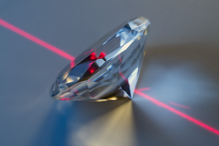 laser beam: closeup of a laser beam impacting on a cut crystal in a diamond Stock Photo