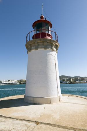 ocea: Ibiza, red lighthouse beacon in port