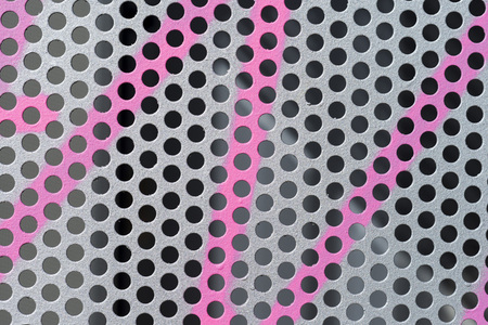 perforated: pink graffiti on background perforated metal
