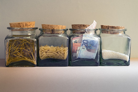inexpensive: Euro notes and food in glass jars. Space for copy Stock Photo