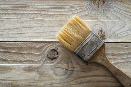 treated board: Wood texture and paintbrush